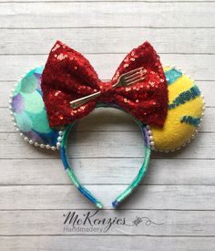 Mermaid Minnie Mouse Ears, Little Mermaid Minnie Ears, Ariel Minnie Mouse Ears, Mickey Mouse Ears. Check out these Little Mermaid Minnie Mouse Ears on my Etsy shop, MckenziesHandmadery! These ears are one size fits most, orders have been placed for children ages 1-8 and have fit great! If you have any questions or concerns, please message me or check the Q&A section of my shop! Thank you for your interest in my magical products! Please note all items are handmade and made to order. Little Mermaid Minnie Ears, The Little Mermaid, Disney Ears Headband, Ear Headbands, Mickey Mouse Ears, Ribbon Sculpture, Handmade Shop, Printing On Fabric, My Etsy Shop
