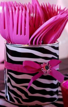 Duct tape around coffee cans with bows/embellishments for silverware holders