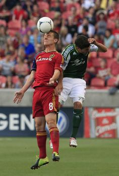 Real Salt Lake midfielder Will Johnson (8) heads the ball as Portland Timbers midfielder Sal Zizzo defends in the first half of an MLS soccer game Saturday, Sept. 22, 2012, in Sandy.  (AP Photo/Rick Bowmer)
