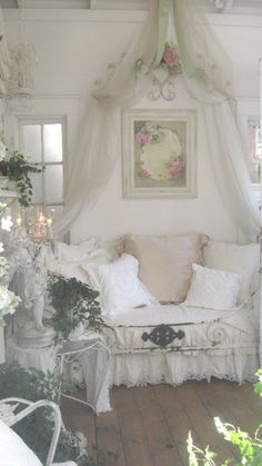 Canopy daybed on a lovely sleeping porch...