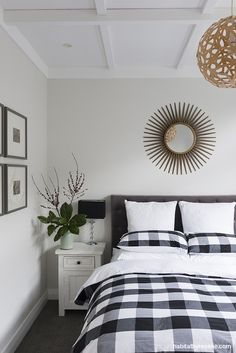 The designers have filled their home with statement furniture and graphic decor, such as this sunburst mirror in the master bedroom. The walls are painted in Resene Merino. Photo by Helen Bankers/Cave. White Bedroom, Master Bedroom, Bungalow Dining Room, Neutral Color Scheme, Colour Schemes, Bungalow Renovation, Interior Paint Colors, Beautiful Bedrooms, House Colors
