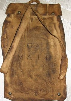 """his is a handmade replica of the old fashioned mail bag.  It's been tea dyed/ coffee stained on muslin.  It's 14""""L x 9.5"""" W.   I have to give credit to Dee Duncan at Ginger and Company, for it was her pattern in which this originated."""