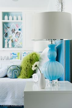 Love the bright blue in this bedroom