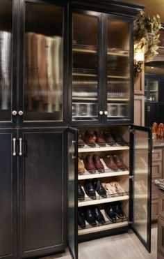 Walk-in closet features stacked black cabinets accented with glass doors filled with rows and rows of slanted shoe shelves. Source by olek shoes Le Closet, Wardrobe Closet, Master Closet, Closet Bedroom, Walk In Closet, Cedar Closet, Closet Space, Closet Doors, Armoire Dressing