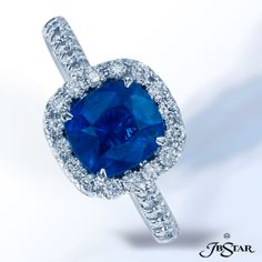Style 0134 Stunning blue sapphire and diamond ring, handcrafted with a 1.74 ct cushion-cut sapphire in a micro pave halo setting. Platinum