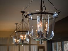 The right lighting choice makes a bold statement, such as this Glass Cloche Chandelier by Ethan Allen (featured in the foyer of the HGTV Dream Home).  Discover more ways to make your home a dream >> http://hg.tv/oxhq