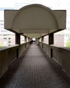 One of the walkways at The Barbican in London. where I was visiting the Bauhaus exhibition. The influence of the Bauhaus continues. Brick Arch, Personal Investigation, London Architecture, Brutally Honest, Barbican, Walkway, Bauhaus, Arches, Concrete