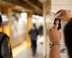 Artist Ming Liang Lu creates intricate portraits out of paper of people on the L train platform in Union Square. Under his fast fingers, paper turns to caricature in a matter of minutes. The finished portraits go up on the wall of the subway, a makeshift gallery.