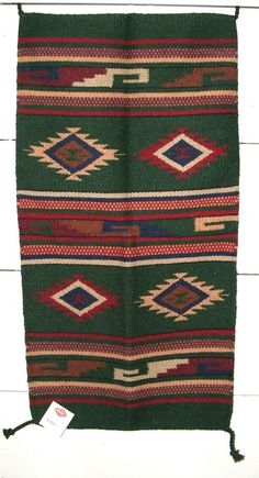"A quality woven wool throw rug with a nice southwestern flair. Measures 20x40"" & has tasseled corners. Heavyweight & durable enough for everyday traffic, yet so pretty, you may just want to hang it on your wall! $39.95 #rug #southwestern #throwrug"