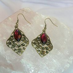 Purple and Gold Dangle Earrings Beautiful purple rhinestone in antique gold setting earrings. Happy Poshing!  Discount with Bundles!  No PP, Merc, Trades or Holds please!  Suggested User/ Trusted 5-Star Seller   THANK YOU FOR VISITING! Jewelry Earrings
