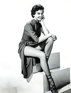 Leslie  Caron I SO wanted to be her - her hair,  talent, impishness, those LEGS and her quintessential Frenchness...