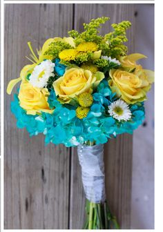 Yellow roses. Daisies. Blue flowers. Bouquet