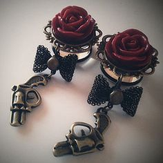 I'm in love with these dangly and girly gauges/plugs with a rose and gun!