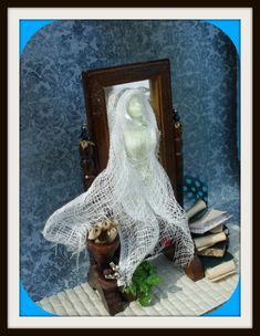 Gothic haunted Ghost Witch coming from mirror dollhouse miniature ooak she glows in the dark. $51.00, via Etsy.