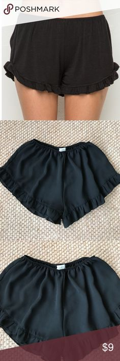 BLACK - Brandy Melville - Ruffle Shorts Brandy Melville - BLACK - Ruffle Shorts by John Craft.   Like New! Perfect. One size.   1st photo is BM stock of similar shorts. All others are of actual shorts.  Brandy Melville - Black Ruffle Shorts  Soft black pull-on shorts with an elasticized waistband and contoured hem with ruffled trimming.  Great condition!  100% rayonne Brandy Melville Shorts