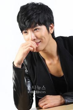 No Min Woo. His hair and dimple make up for the zip-off sleeves :D