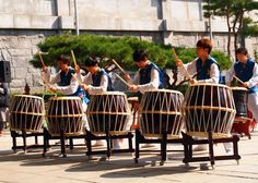 A team of musicians perform a traditional Korean drum number in front of the National Folk Museum of Korea in Gyeongbokgung Palace.