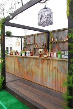 Hello Shabby Chic! This rustic bar was custom created for a special bride's outdoor wedding. Complete with galvanized steel front, moss and birdcage detail with wood pallet bar backs. #rusticchicweddingideasbudget