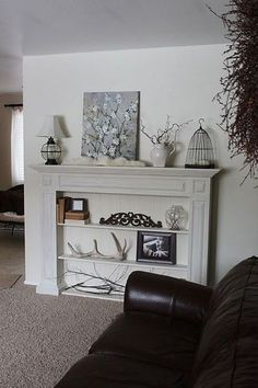 faux fireplace bookcase - might be a good idea to close off the old fireplace. make a useful space!
