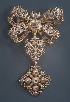 Bow Brooch with Pendant --  Date: 18th century probably Spanish Gold, diamonds Dimensions: 2-3/4 x 3-13/16 in. (7.0 x 9.7 cm)