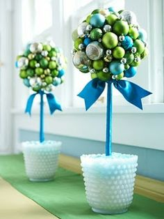 Blue, green, and silver balls to make a topiary