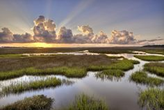 Sunrise over the St. Johns River at Round Marsh, in the Theodore Roosevelt Area of the Timucuan Preserve in Jacksonville, Florida.
