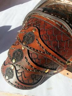 A set of hand stitched, laser etched shoulder armour made for a lion tamer :-)
