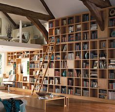 Library with high ceilings and a sneaky loft to have a read