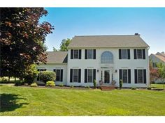 Beautiful updated colonial on prime oversized lot! 2 story foyer with hardwoods! Much crown molding