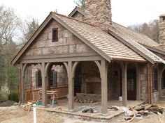 Poplar bark siding and I dig the fireplace in the porch