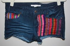 Denim Cutoffs with Navajo/Aztec Fabric on pockets. $21.00, via Etsy.