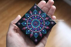 This is an original hand painted dot mandala on canvas that comes with its own wood easel ( stand ). I love the look of the miniature paintings; Its a cute little decoration with enormous energy! The mandala flower is bright and colorful and has rhinestones for a touch of sparkle.
