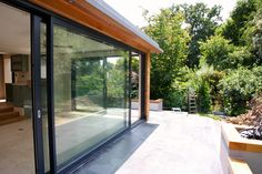 I thought people finding this board might like to see how the extension worked out... Large sliding doors (Shucho) with cedar cladding