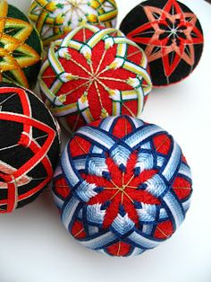 Are these not gorgeous? Empress Wu Designs says they're inspired by traditional Japanese temari, made fpr children to play with, and easy to make. Would love to put a bunch in a bowl, hang from threads or put on a Christmas tree...