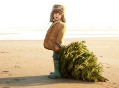 Toddler on Beach with Christmas Tree