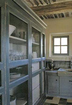Chicken wire cabinet fronts
