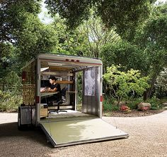 This is the first time I'd seen a utility trailer turned into a backyard home office/studio. This one belongs to landscape architect Andreas Stavropoulos. He pulls it to worksites behind his Honda CR-V. Not surprising Andreas lives full time in an Airstream.