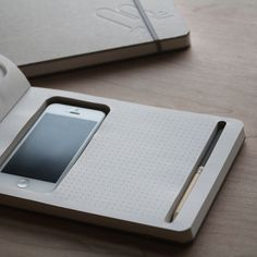 Phone+Book is a minimalist design created by Taiwan-based designer KB. Phone+Book is a new way to connect your digital inspiration and analogy creation. Easily put your phone inside the notebook, browsing and getting information through it. Filofax, Le Manoosh, Phone Books, Smartphone, Best Phone, Cool Gadgets, Tech Gadgets, Magazine Design, Industrial Design