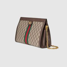 038eda5dabe1 Shop the Ophidia GG medium shoulder bag by Gucci. Crafted in GG Supreme  canvas with
