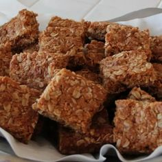 Crunchies - Traditional South African Oatmeal Cookie Bars with Oats, Unsweetened Shredded Coconut, All Purpose Flour, Granulated Sugar, Table Salt, Ground Cinnamon, Butter, Margarine, Golden Syrup, Low Fat Milk, Baking Soda, Vegetable Oil Spray.