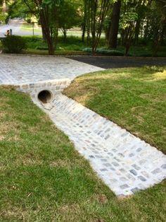 Driveway Culvert, Cobbled Driveway, Cobblestone Driveway, Driveways, Landscaping On A Hill, Driveway Landscaping, Landscaping Ideas, Monuments, Driveway Apron