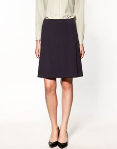 SKIRT WITH PIPING ON POCKETS  49.90 USD