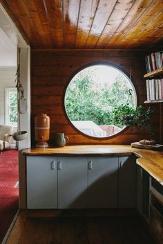 Round window in the kitchen of a super relaxed, boho cottage in Australia
