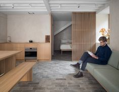 Izat Arundell has converted a former blacksmith's workshop in Edinburgh into a compact apartment featuring a muted material palette and sliding screens.