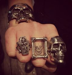 I really like the middle one, I think it's just the frame and the skull is a tat