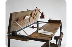 Amazing desk idea made from an antique door. Can modify the design so that it is hinged for both halves, thus converting it into a drafting table/desk