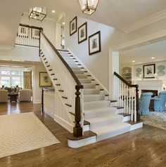 This gorgeous central staircase is layered with a soft and simple wool runner, effectively muffling the sound of footsteps as well as protecting the finish on the treads and risers.