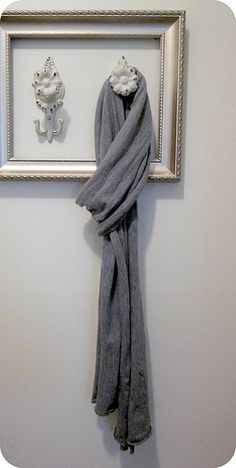 What a cute idea and you could move it around to different spots if need be!  frame and knobs for an entry way coat/scarf hanger.