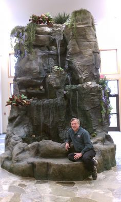 Accessories, : Wonderful Indoor Waterfall With Natural Like Dark Brown Stone And Layered Small Waterfall Design Beautified With Flowers And Plants Indoor Waterfall Fountain, Garden Waterfall, Indoor Fountain, Small Waterfall, Indoor Water Features, Water Features In The Garden, Backyard Water Feature, Ponds Backyard, Backyard Waterfalls