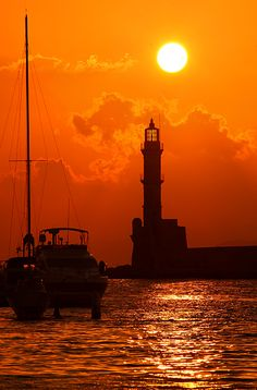 "A sunset from the old Venetian port of Hania. Here you see the lighthouse of Hania, often called ""Egyptian lighthouse"",  Creta Greece by Cretense"